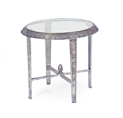 A SILVERED METAL AND GLASS TOP