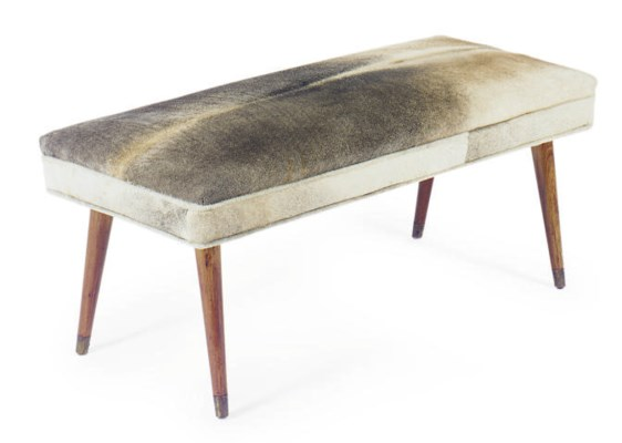 A MAHOGANY, BRASS AND COWHIDE