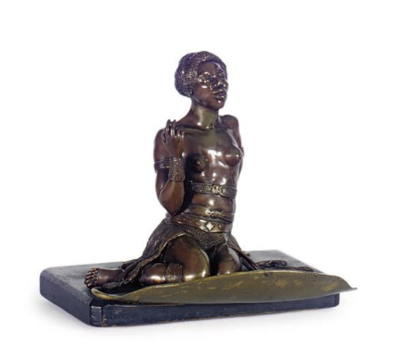 A PATINATED BRONZE AND EBONIZE