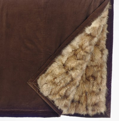A COYOTE SKIN FUR AND BROWN VE