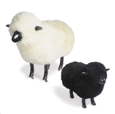 TWO EBONIZED AND WOOL FIGURES