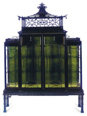 AN EBONIZED CABINET-ON-STAND,