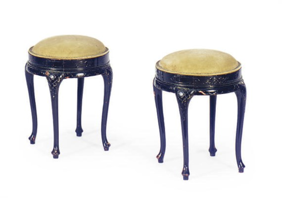 A PAIR OF EBONIZED AND UPHOLST