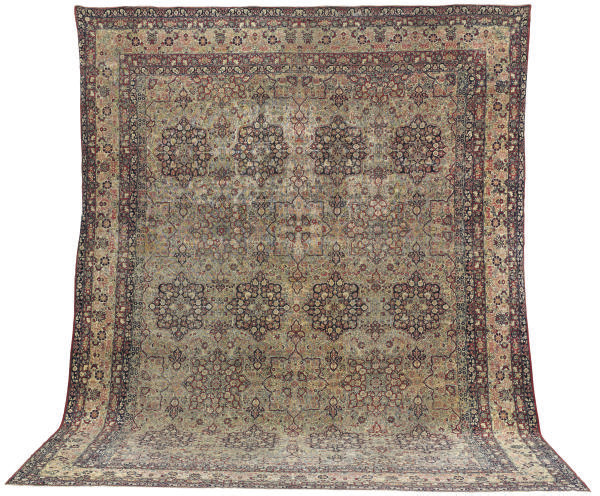 A LAVAR KIRMAN CARPET,