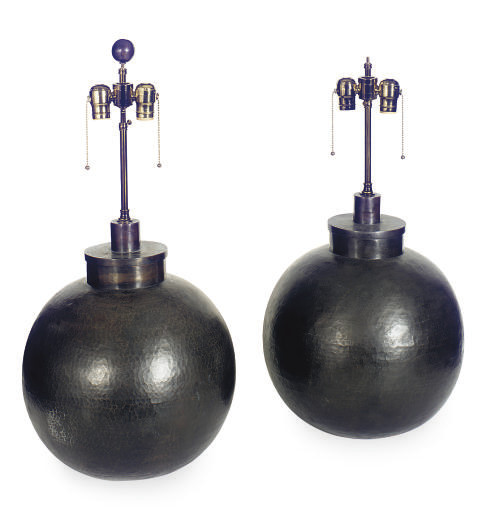 A PAIR OF HAMMERED METAL ROUND