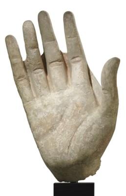 A large stucco hand of Buddha