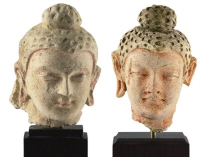 Two small stucco heads of Budd