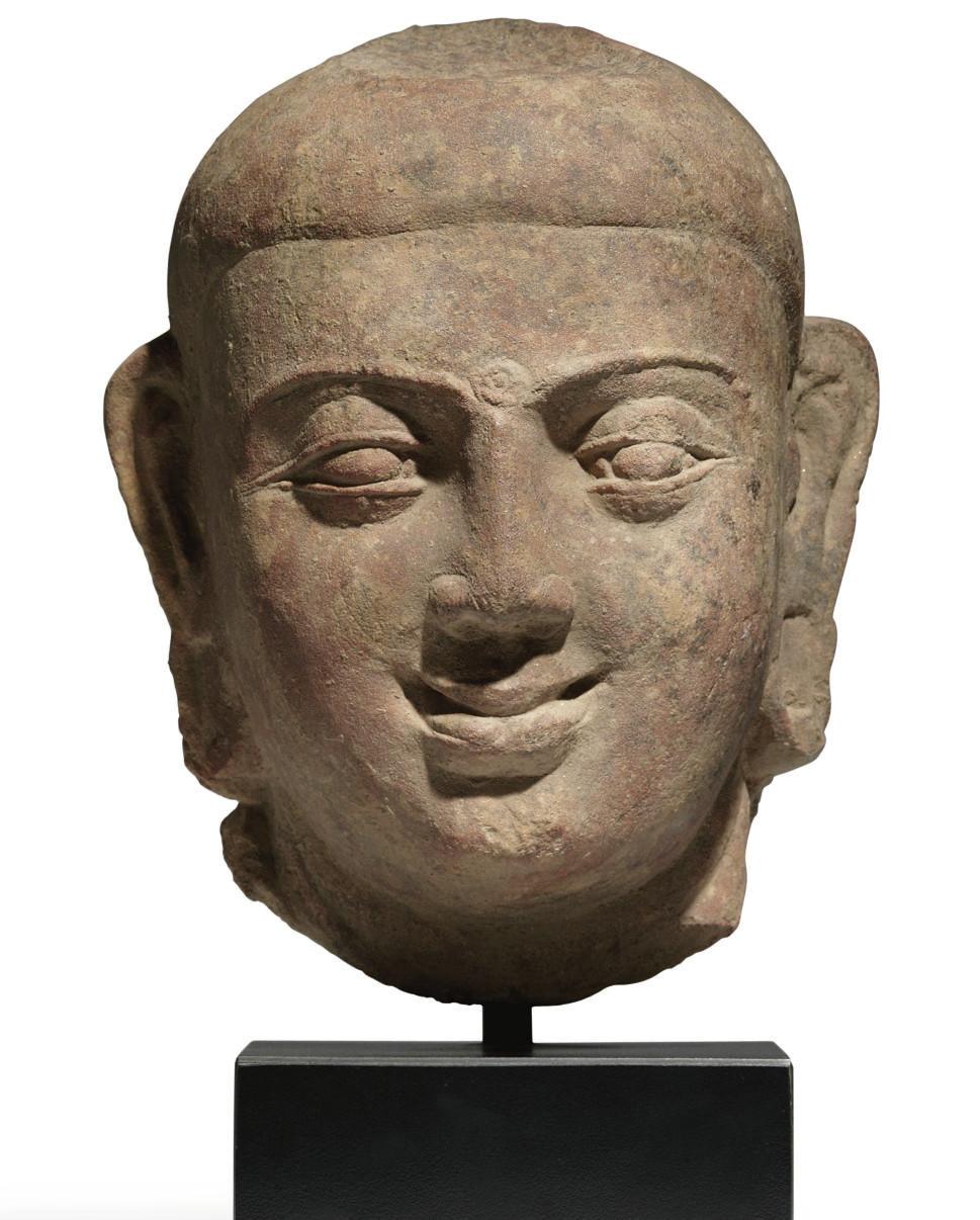 A red sandstone head of Buddha