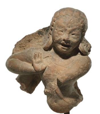 A terracotta figure of a danci