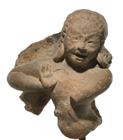 A terracotta figure of a danci