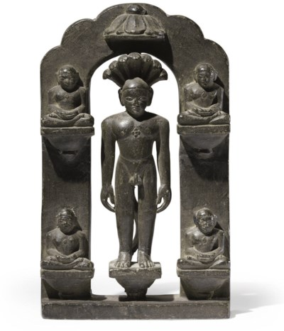 A black stone figure of Jina P