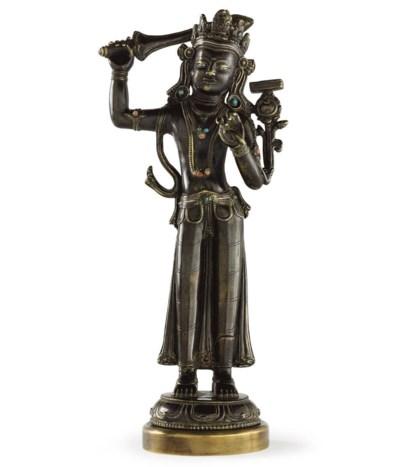 A bronze figure of a standing