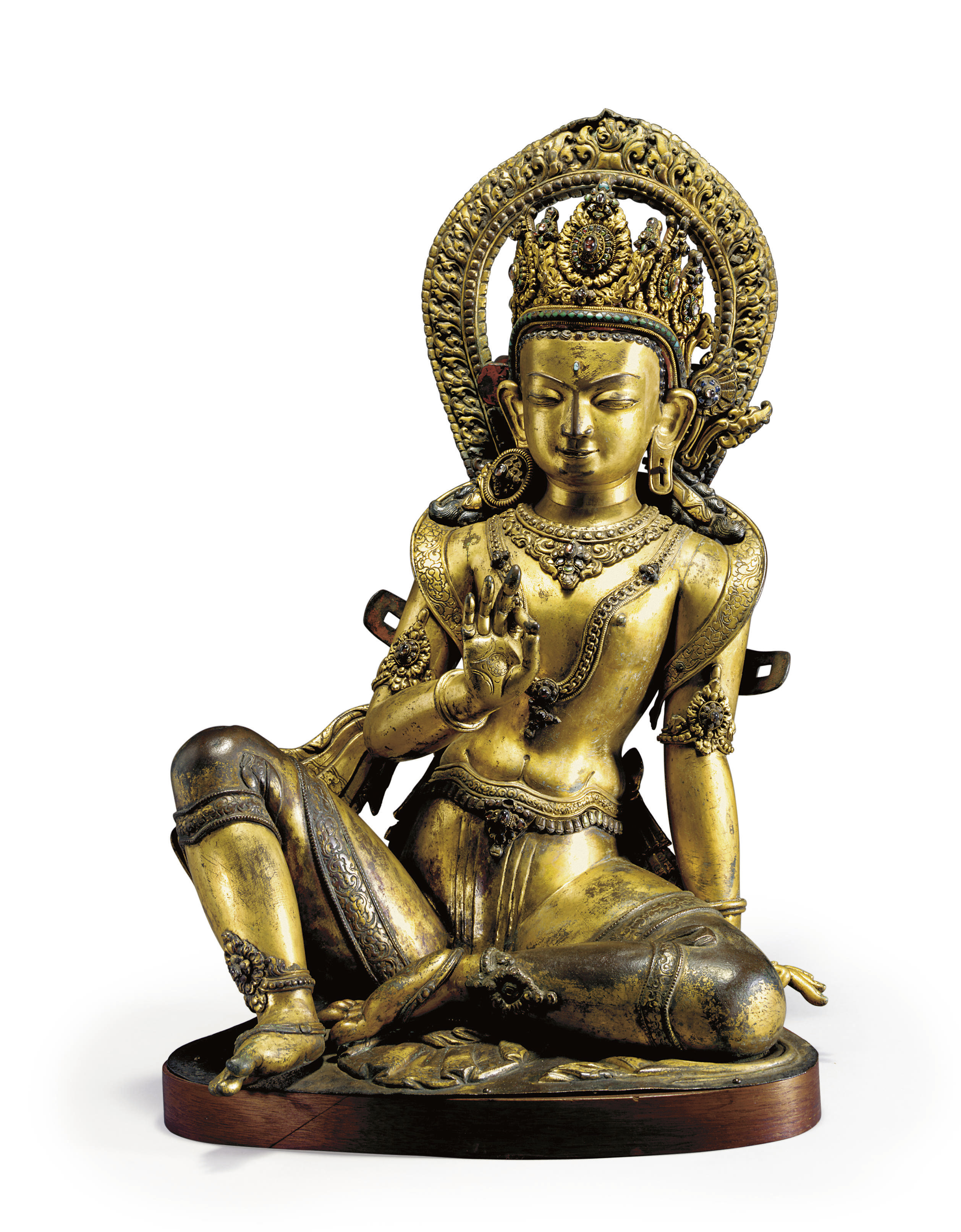 A gilt copper repousse figure