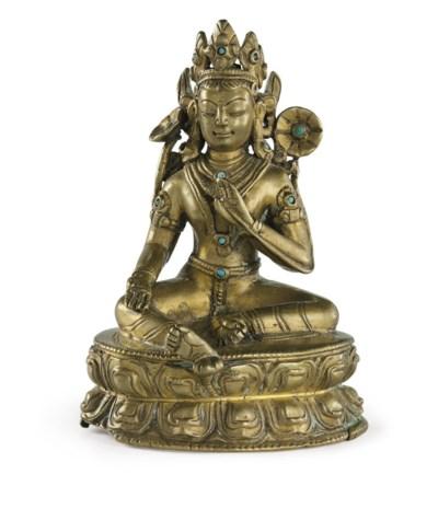 A bronze figure of Tara