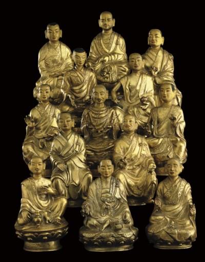 A group of thirteen gilt figur