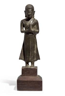 A small bronze figure of a sta