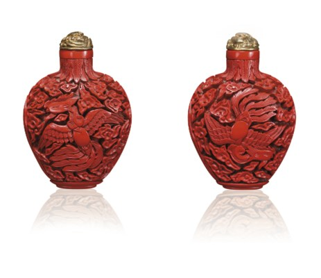 **A CARVED CINNABAR LACQUER SN