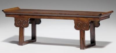A HUANGHUALI RECESSED-LEG TABL