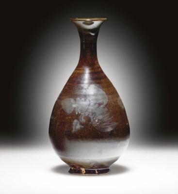 A HENAN IRON-DECORATED OLIVE-B