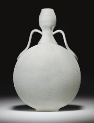 A MING-STYLE WHITE-GLAZED INCI