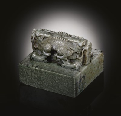 A WELL-CARVED GREY-GREEN JADE