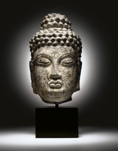 A RARE LIMESTONE HEAD OF BUDDH