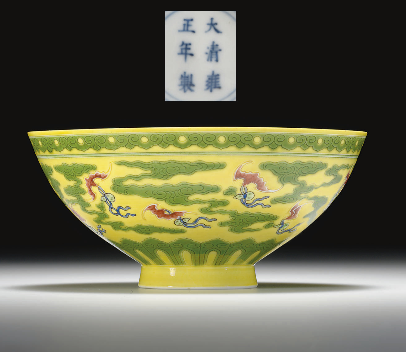 AN ENAMEL-DECORATED GREEN AND YELLOW-GLAZED BOWL