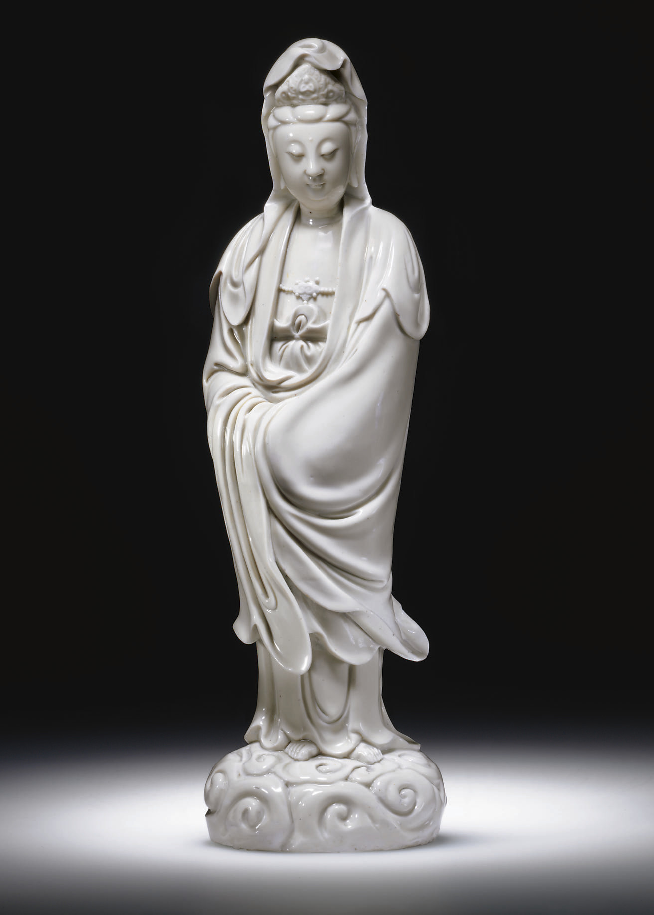 A LARGE BLANC-DE-CHINE FIGURE