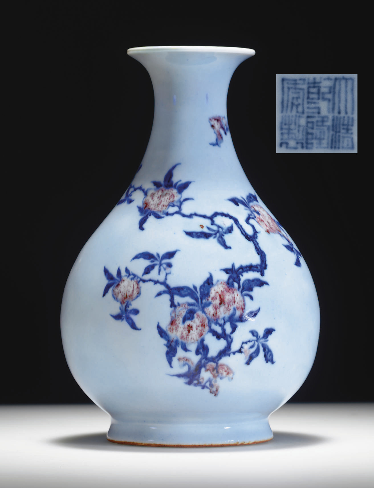 AN UNDERGLAZE BLUE AND RED-DECORATED PALE BLUE-GLAZED PEAR-SHAPED VASE