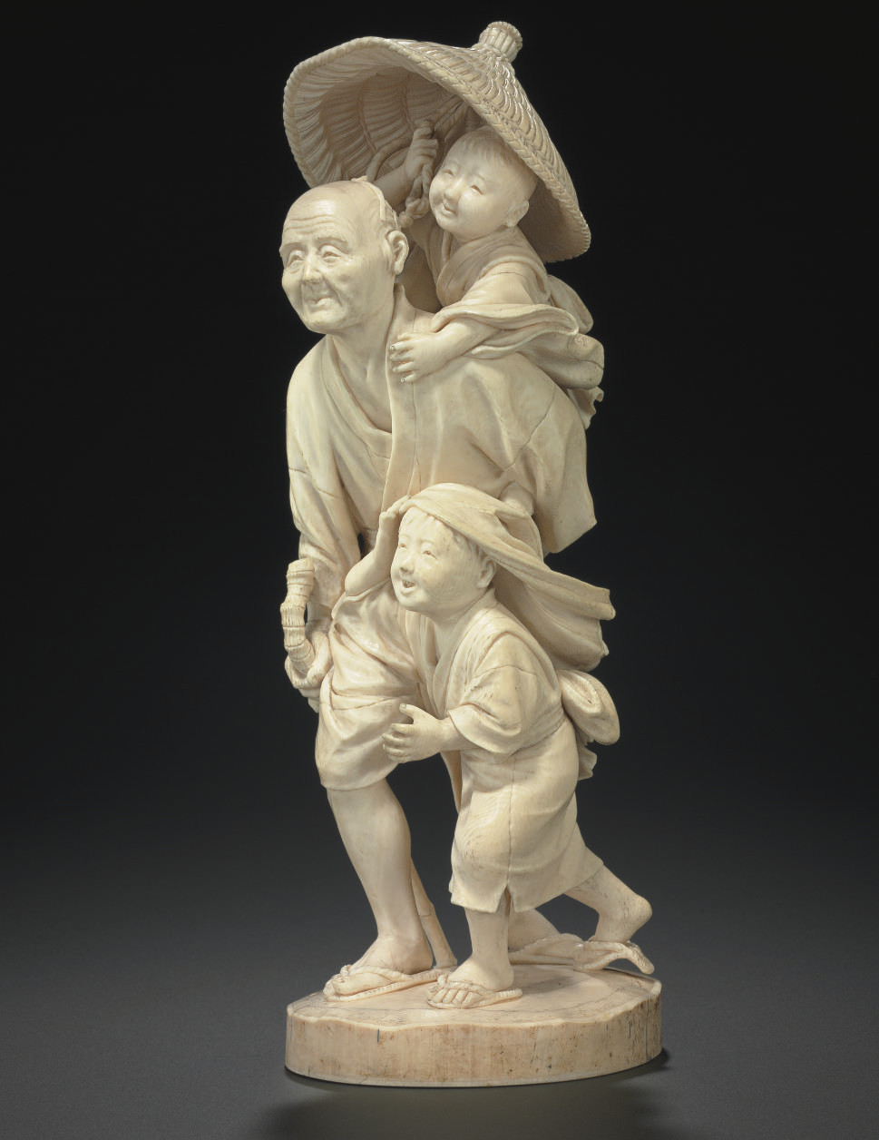 An Ivory Model of a Man and Tw