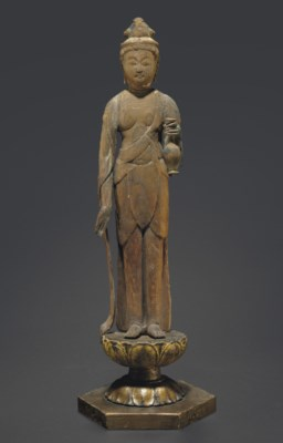 A Wood Figure of a Standing Sh
