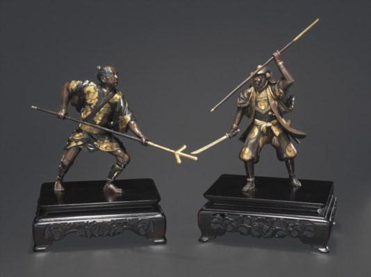 A Pair of Parcel-Gilt Bronze M