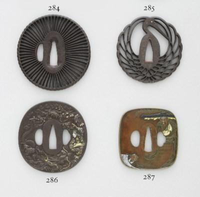 An Inlaid-Iron Tsuba