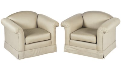 A PAIR OF GREY UPHOLSTERED CLU