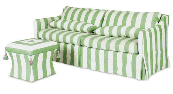A GREEN AND WHITE UPHOLSTERED