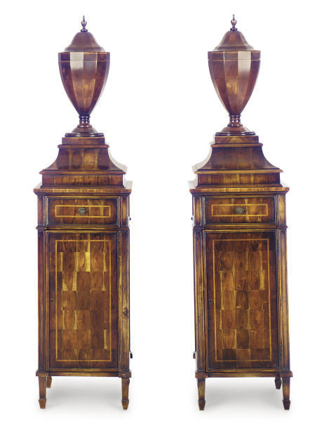 A PAIR OF WALNUT COVERED URNS-