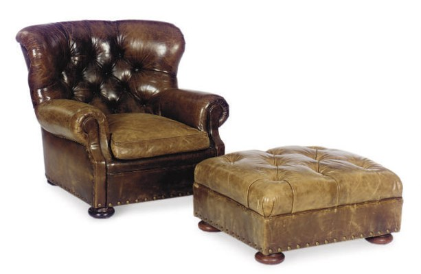 A BUTTON-TUFTED BROWN LEATHER