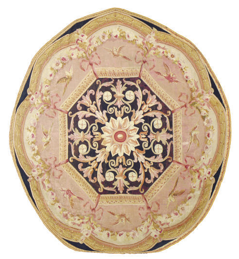 A CIRCULAR AUBUSSON CARPET FRA
