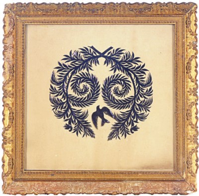 A FRAMED PAPER CUT-OUT,