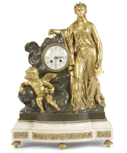 A PATINATED AND GILT-BRONZE AN