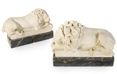 A PAIR OF MARBLE LIONS,