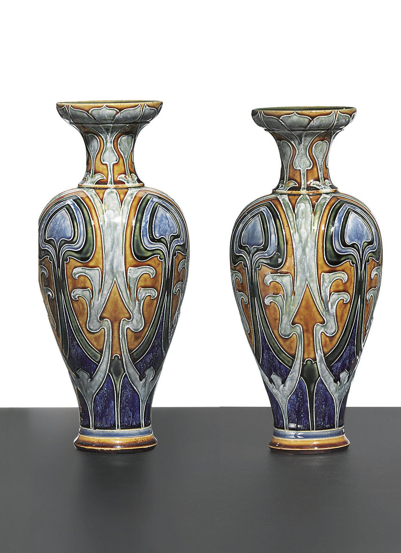 A PAIR OF ROYAL DOULTON STONEWARE POLYCHROME VASES