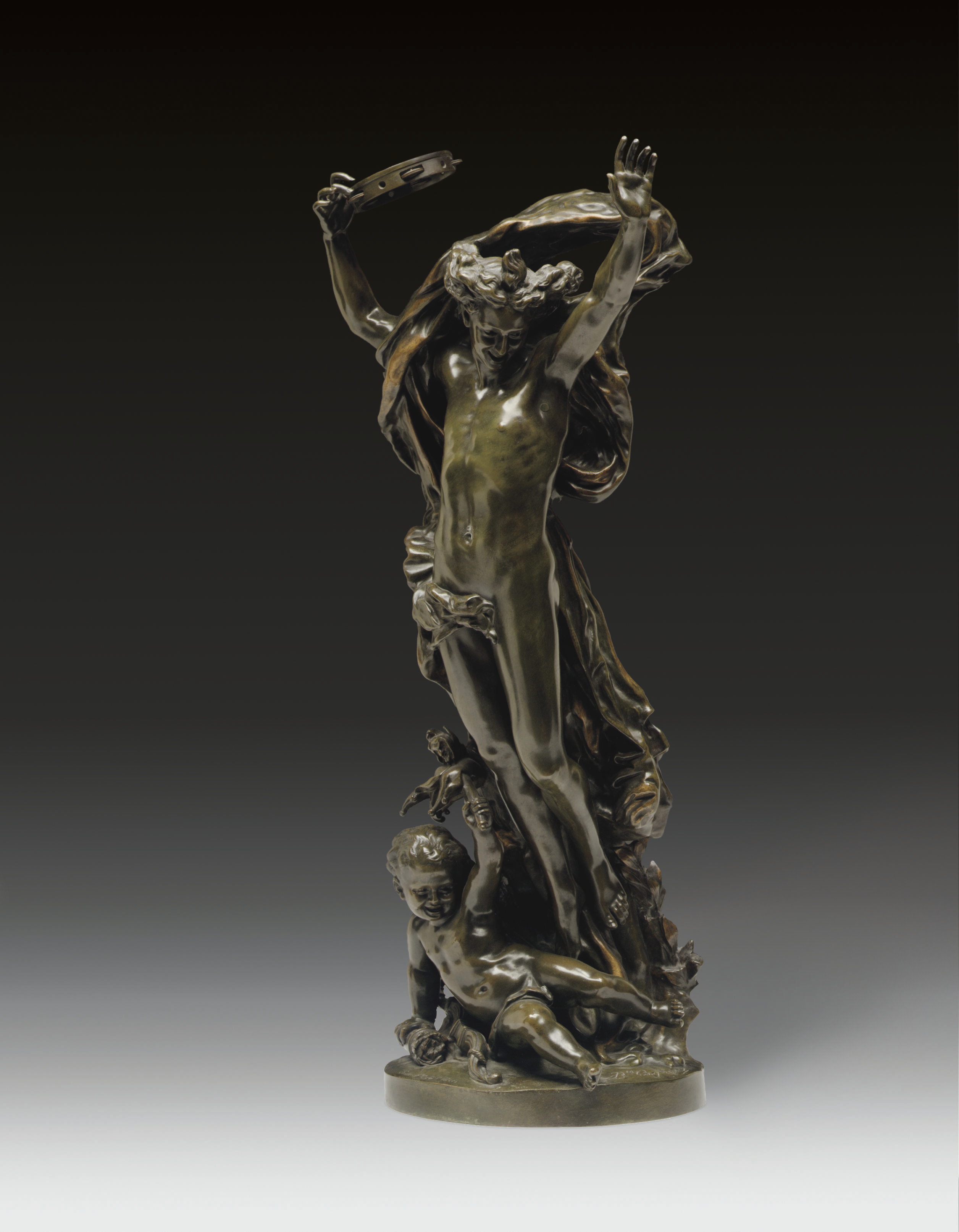 A FRENCH BRONZE FIGURAL GROUP ENTITLED 'GENIE DE LA DANSE'