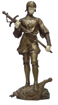 A FRENCH GILT-BRONZE AND IVORY FIGURE OF JEANNE D'ARC**