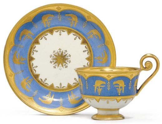 A VIENNA BLUE-GROUND TEACUP AN