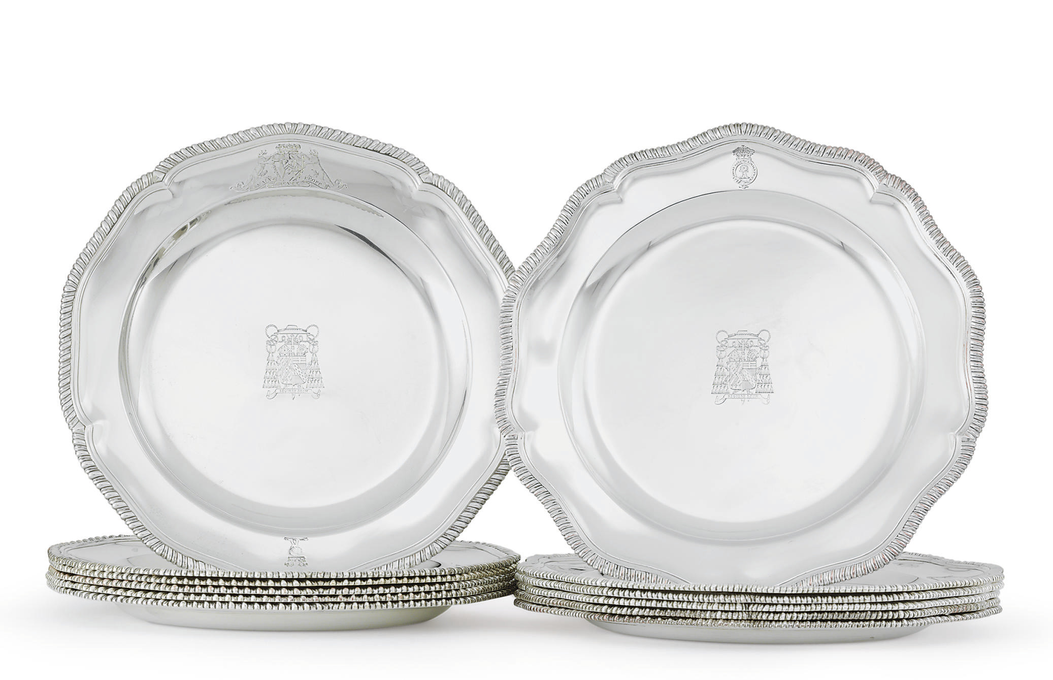 AN ASSEMBLED SET OF TWELVE GEORGE III ENGLISH AND IRISH SILVER DINNER PLATES