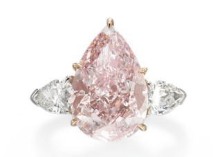 A SUPERB COLORED DIAMOND RING