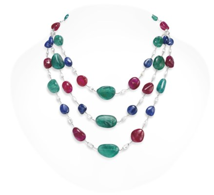 AN EMERALD, RUBY AND SAPPHIRE