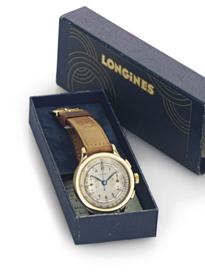 LONGINES. A 14K GOLD CHRONOGRA