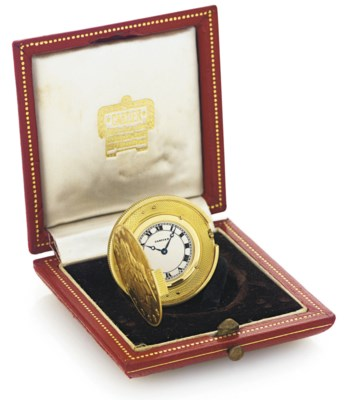 CARTIER. AN 18K GOLD COIN WATC